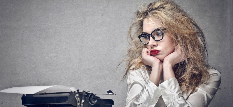 beautiful journalist looks typewriter (Demo)